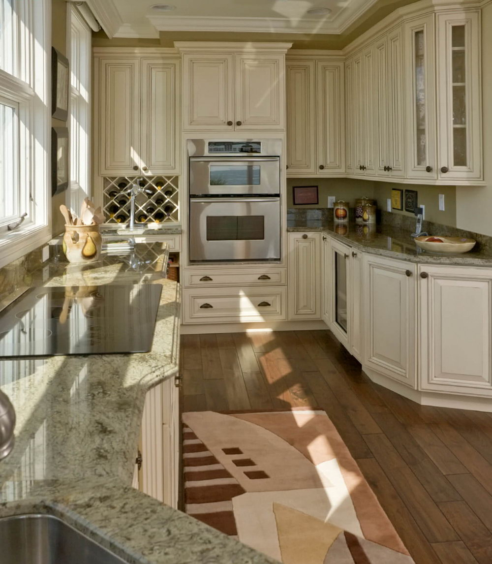 Kitchen With White Cabinets And Wood Floors