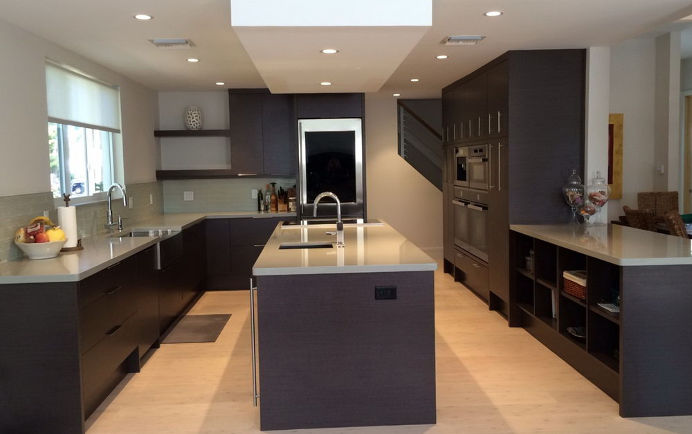 Oak Kitchen Cabinets With Granite Countertops And Black Appliances