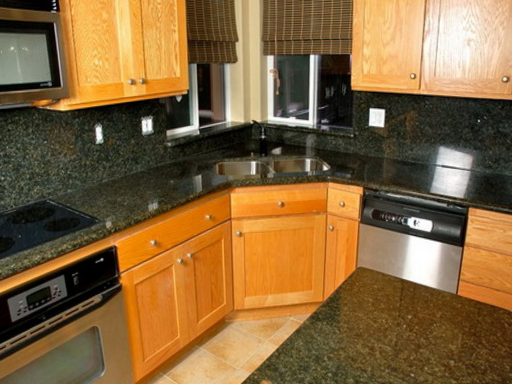 Brown Kitchen Cabinets With Black Granite