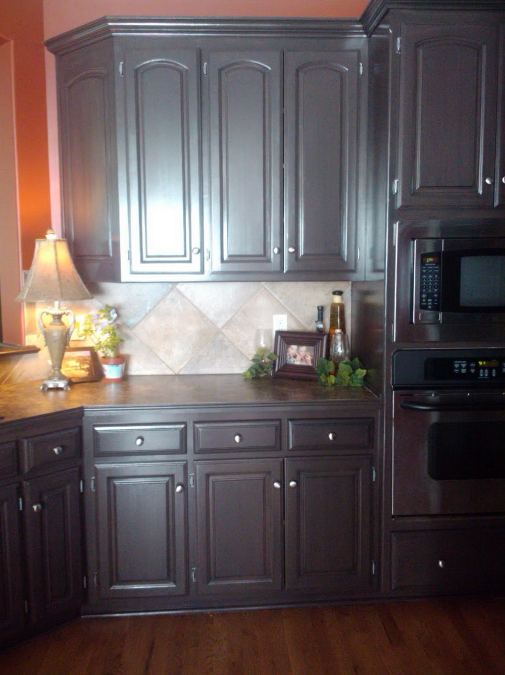 Brown Kitchen Cabinets With Dark Floors