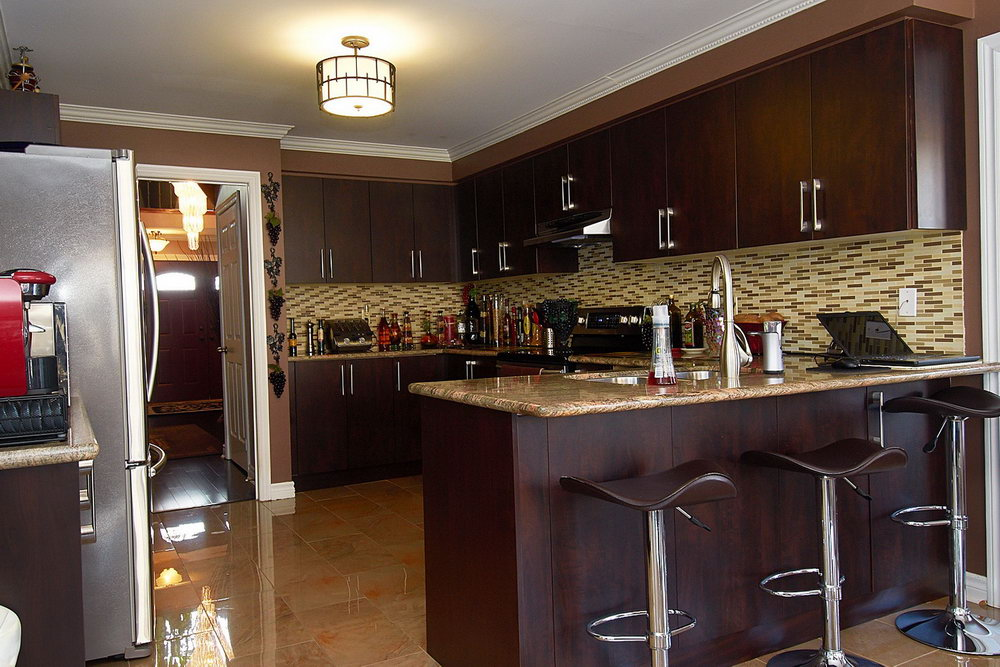 Brown Kitchen Cabinets With Stainless Steel Appliances