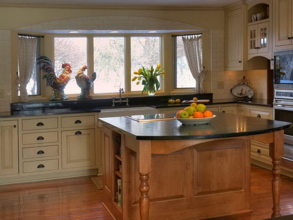 Cream Colored Kitchen Cabinets With Dark Countertops