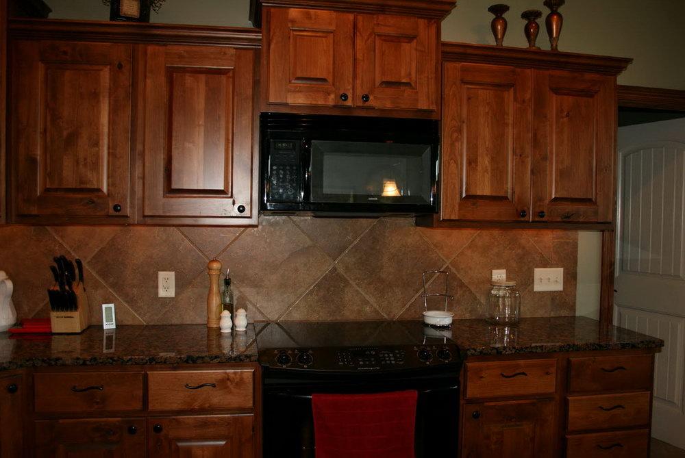 Dark Knotty Alder Kitchen Cabinets