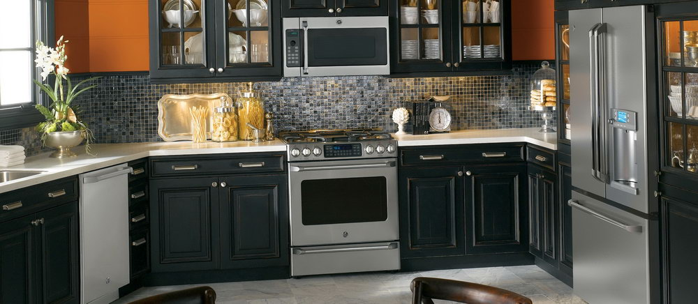 Kitchen With Black Cabinets And Stainless Steel Appliances