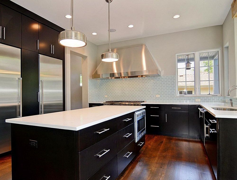 Kitchen With Dark Cabinets And White Counter