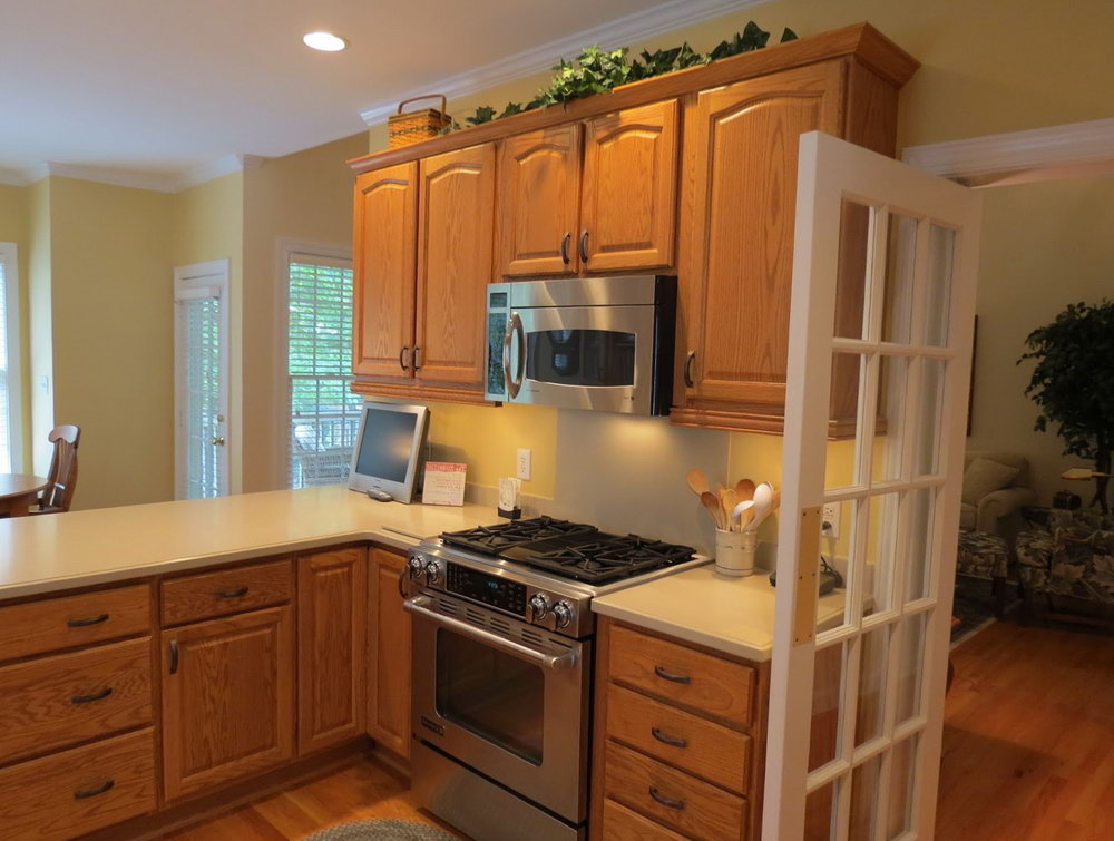 Honey Oak Kitchen Cabinets With Dark Wood Floors