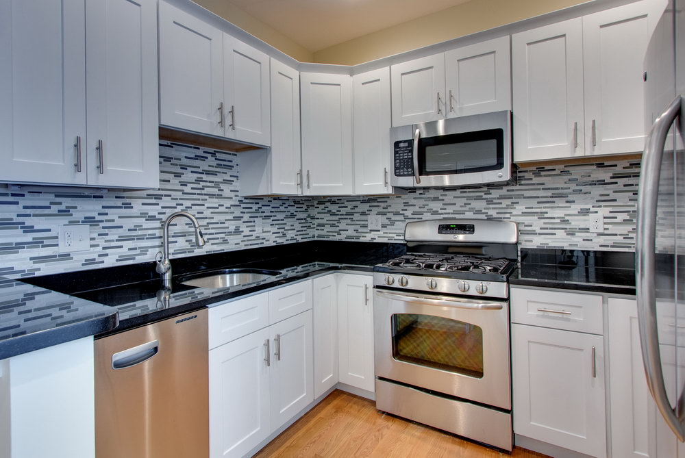 White Kitchen Cabinets With Black Granite Tops