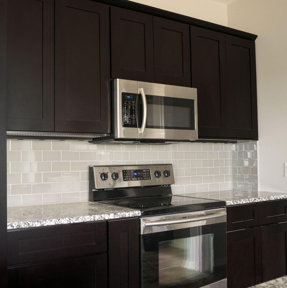 Galley Kitchen Dark Cabinets