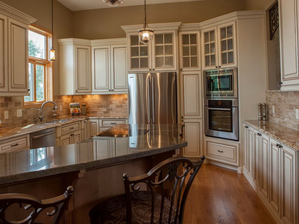 Tuscan Style Kitchen With White Cabinets
