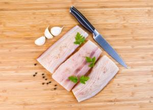 White Fish Fillets being prepared for Cooking