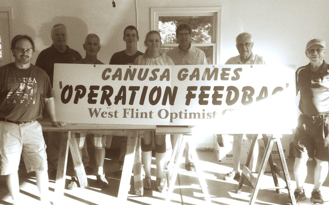 Members of West Flint Optimists Pack Lunches for CANUSA Kids