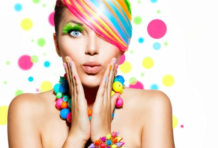 A girl with colorful hair and make-up