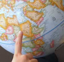 - pointing at the globe