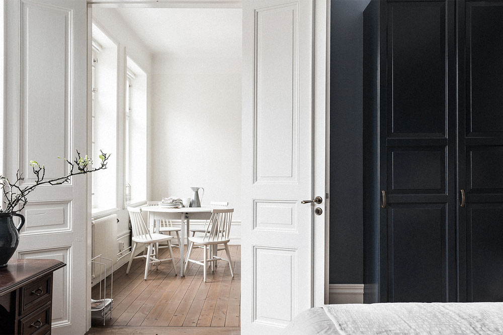 Oracle-Fox-Sunday-Sanctuary-White--Scandinavian-Dining-Room-Interior-Wooden-Floors-Black-Door