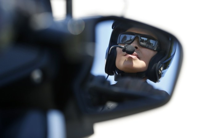 MOTOR Officer Kathy Anderson and her colleagues at the GGPD are out in force cracking down on distracted drivers and those who don't obey other traffic laws. (File photo by Steen Georges/Behind the Badge OC)