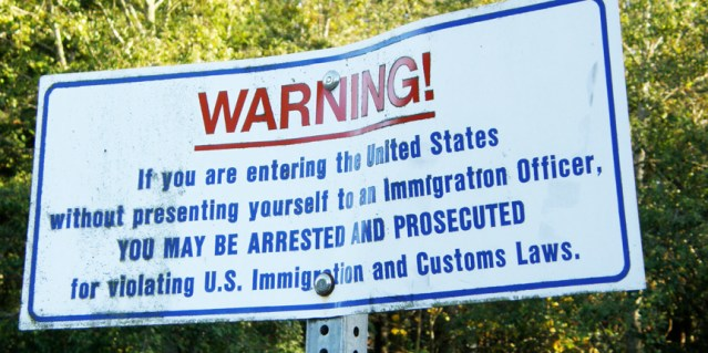 THIS SIGN is at the U.S.-Canadian border (Wikipedia photo).