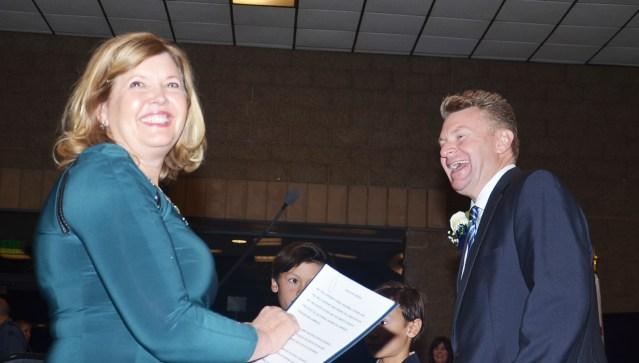 NEW MAYOR Steve Jones is happy to be sworn in by one-time Garden Grove community development director Susan Emery (OC Tribune photo).
