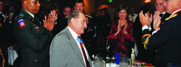 """TIMOR """"TED"""" RUBIN honored at a military banquet."""