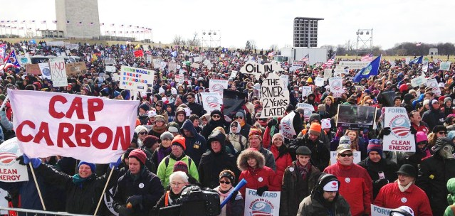 DEMONSTRATORS against the Keystone pipeline extension gather in 2013 (Wikipedia photo).