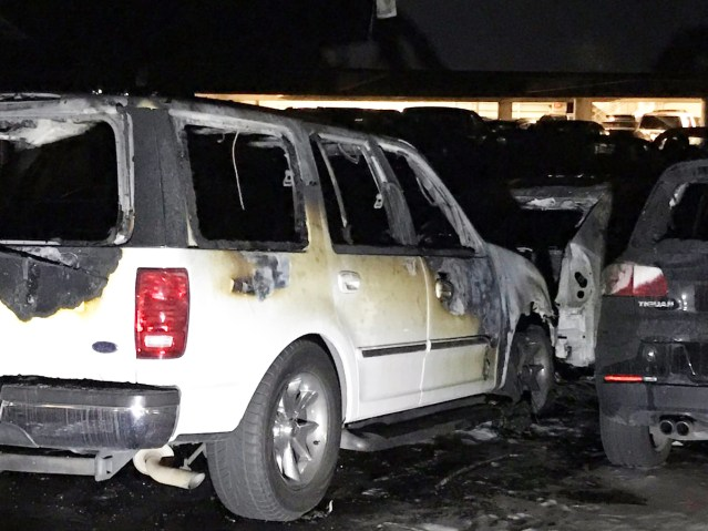 A FIRE-DAMAGED vehicle in a parking structure at the Disney resort in Anaheim Monday afternoon and evening (Anaheim Fire and Rescue photo).