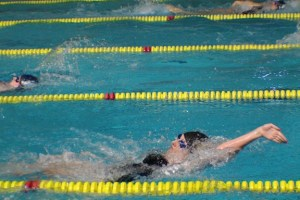 Sophomore Katie Jensen swims in the Relay