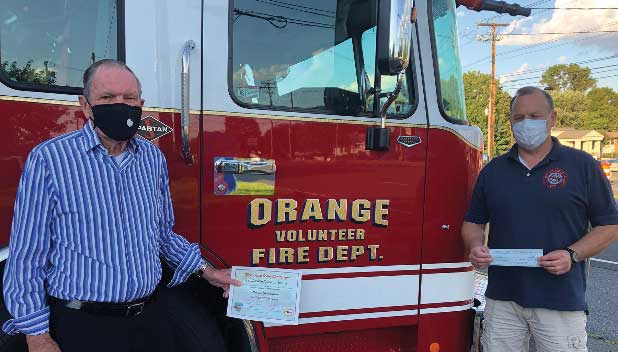 Robert Archambault of the Orange Foundation, a Premier Donor, with Fire Chief Vaughn Dumas