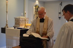 Fr Robinson blesses the habits