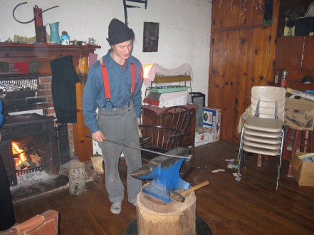Jamie bending metal by the warmth of the fire in, yes, his living room.