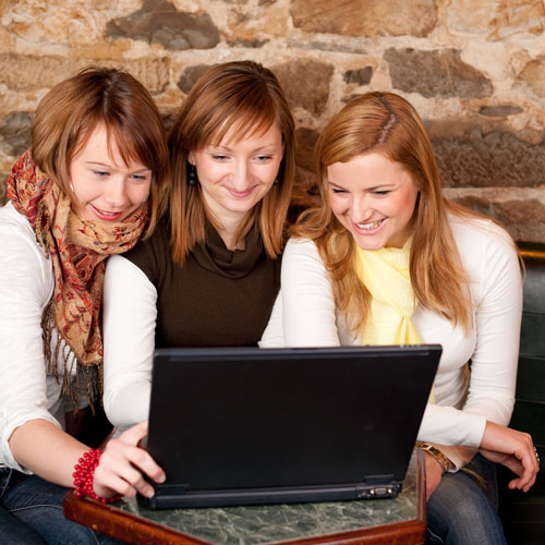Three women searching for local products and services online