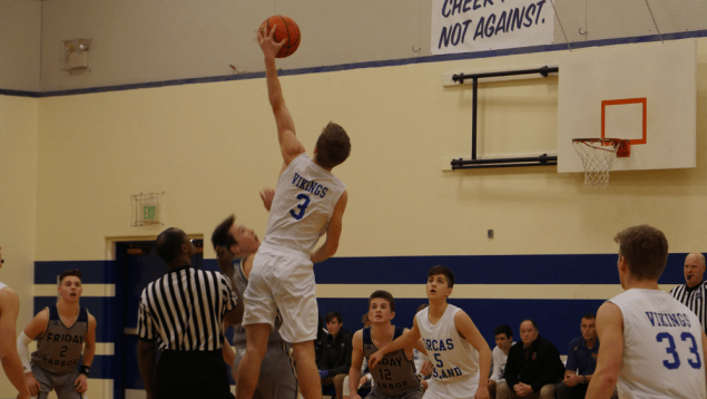 OIHS about to score on FHHS during a basketball game.
