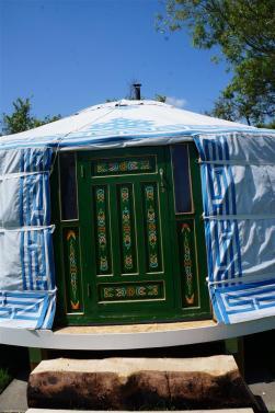 The yurt door, handpainted in a Mongolian design
