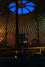 At night the yurt is lit by candles and solar lights