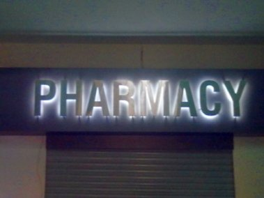 Pharmacy steel letters on studs with all weather LEDs as back glow