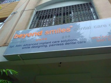 Smiles - polycarbonate board with acrylic and vinyl pasted letters profile