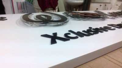 Walnut - 2 ply acrylic letters - profile shop
