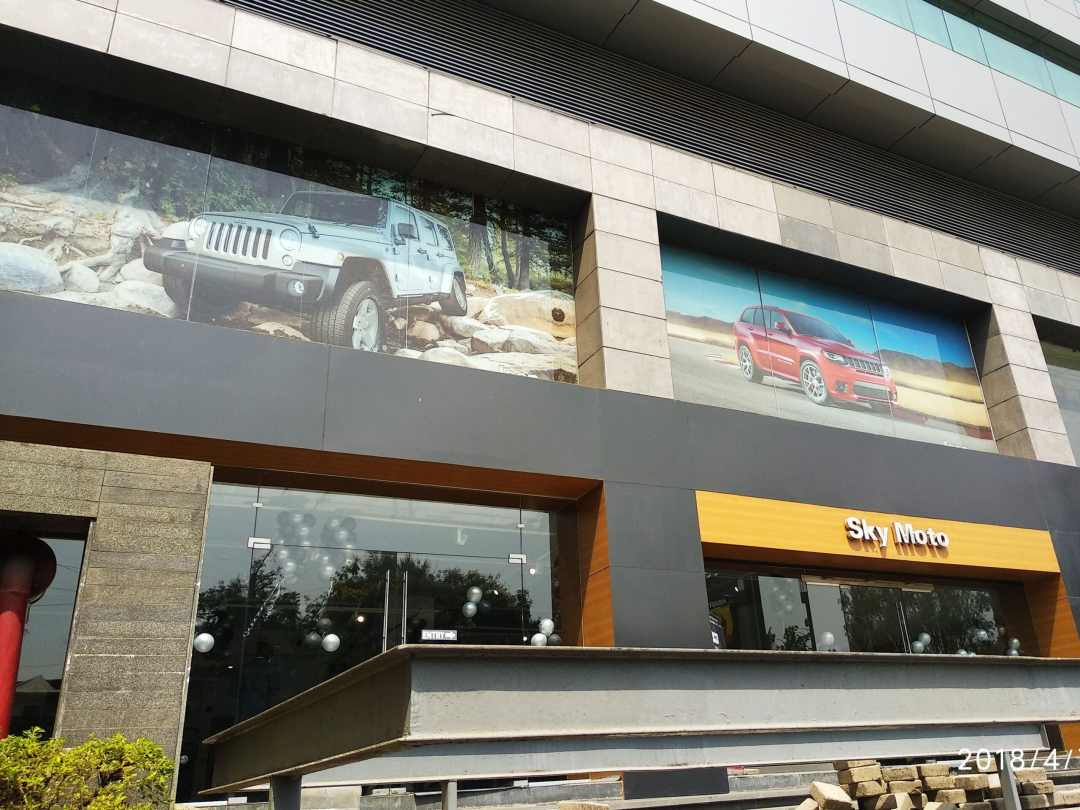 building windows used for advertisements using one way vision film