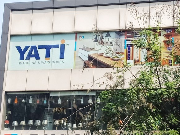 digital printing on frosted glass film pasted on the first floor of a building facade for the YATI company
