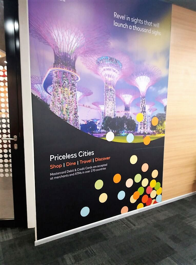 Corporate branding achieved via a custom designed wall decal pasted in an office showing a scene from Gardens by the Bay in Singapore