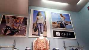 store branding done in a mall using photo prints on sun board