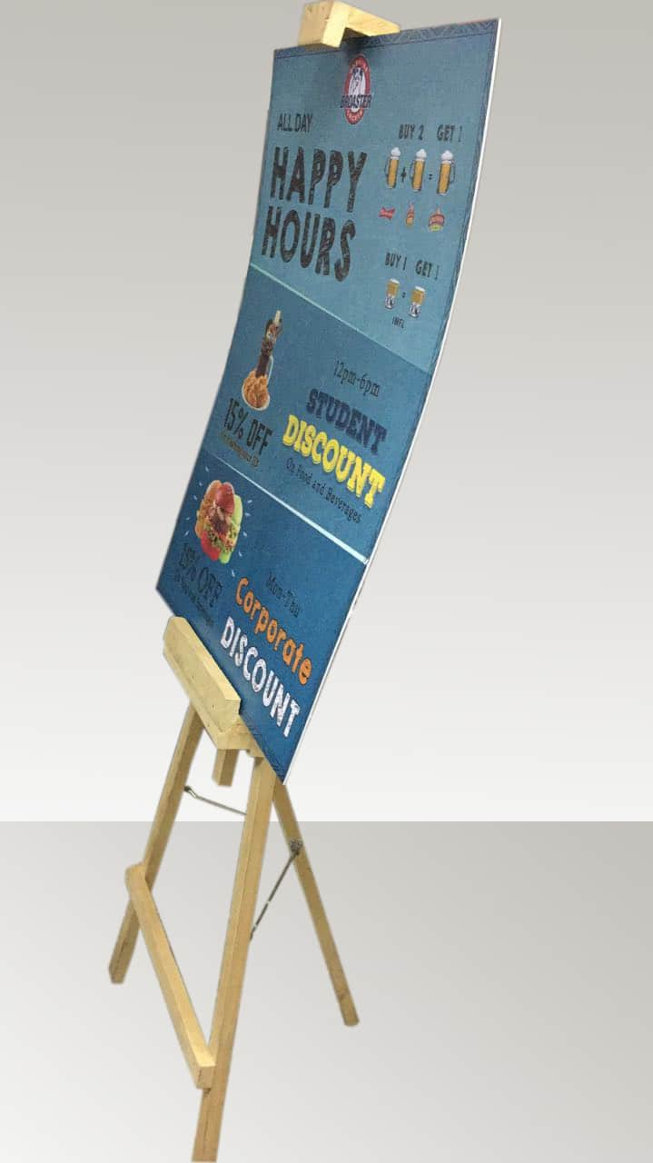 painters stand holding printed fomasheet display signs