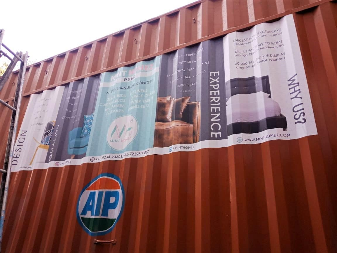 Commercial vehicle branding on the uneven corrugated surface of a container truck using UV printed cast vinyl