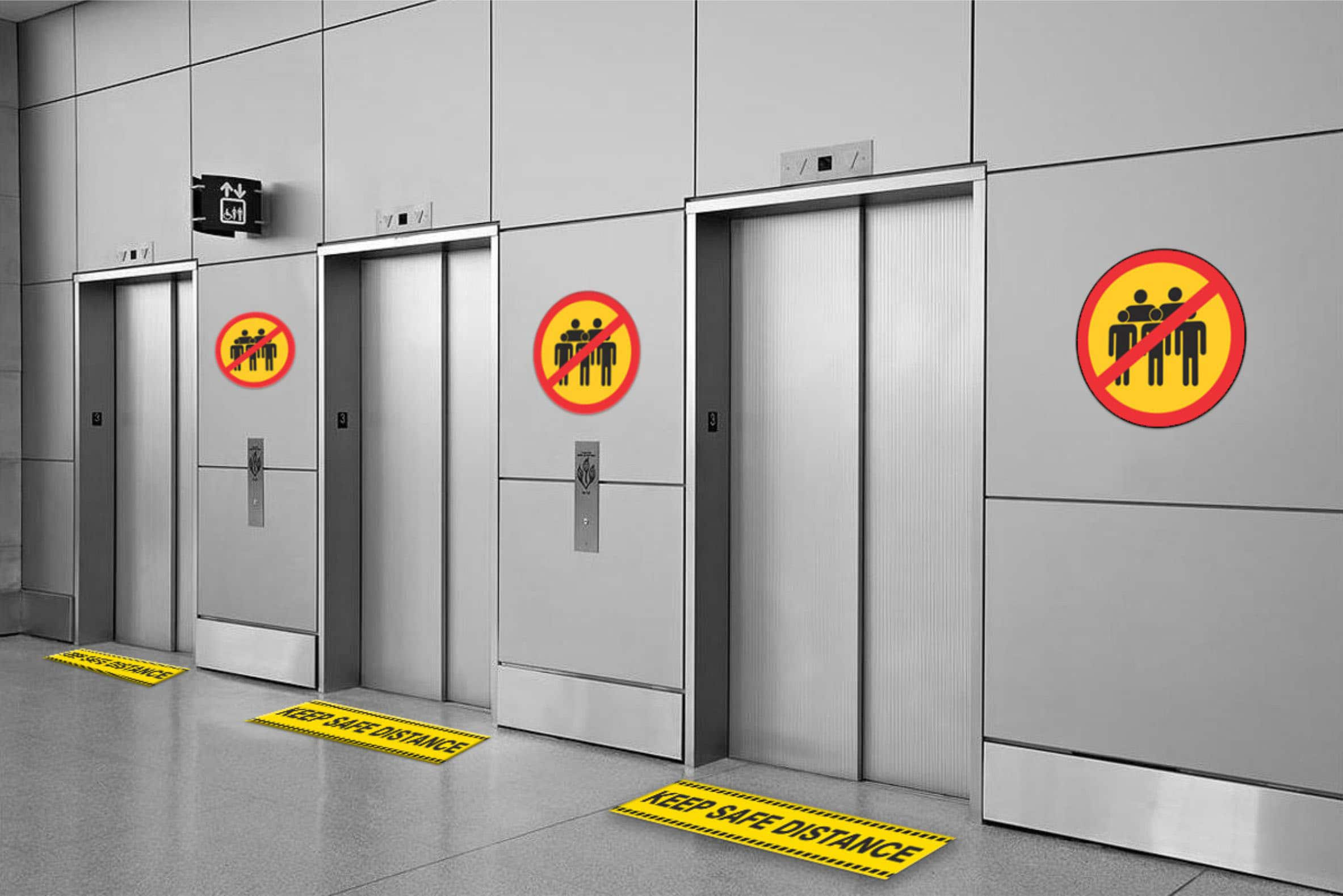wall and floor stickers asking people to keep distance and avoid crowding in a lift