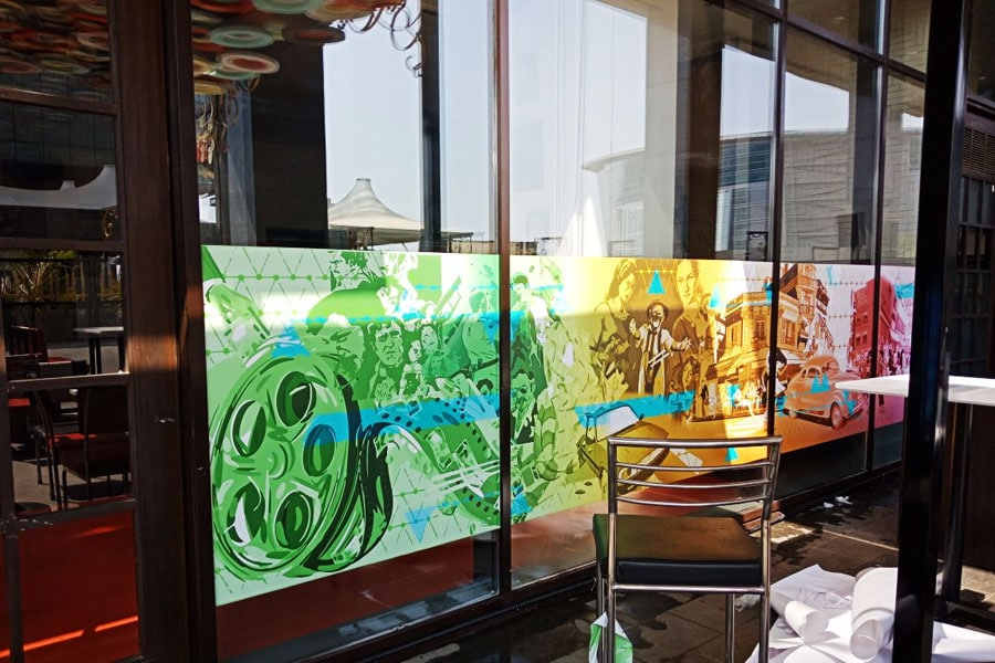 Inkjet printed opaque film pasted on a glass facade of a cafe to enhance the decor of the restaurant
