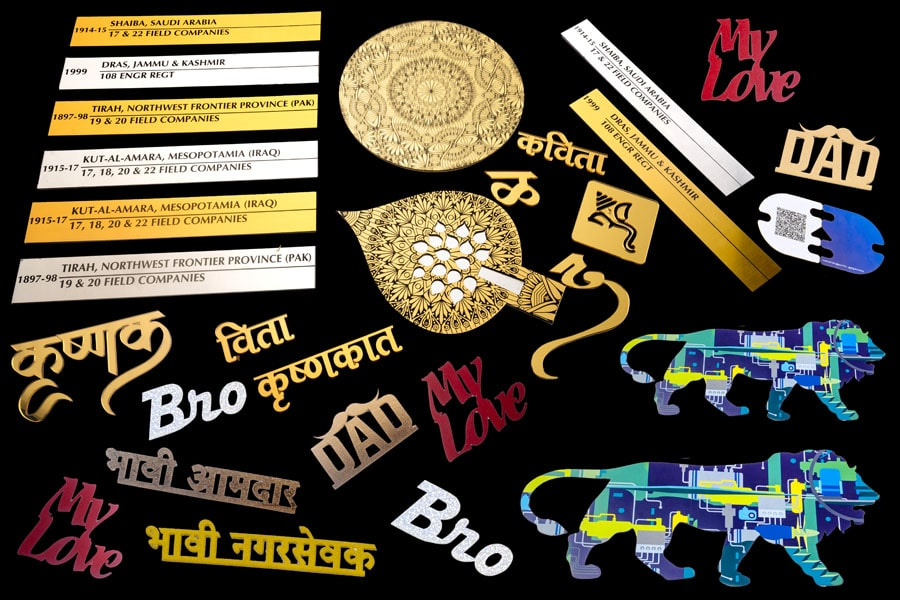 collage of products laser cut and engraved including cake toppers of paper, gold finish letters of acrylic, metal engraved plates, laser cut visiting cards, name plates, etc.