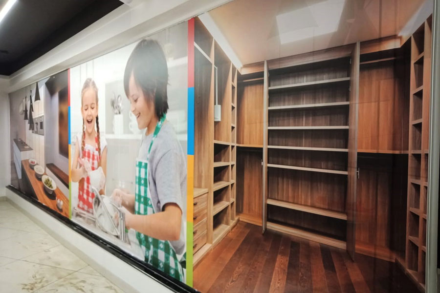 Inkjet printed high resolution photo vinyl print having images of small children pasted on a wall to enhance the interiors of a home