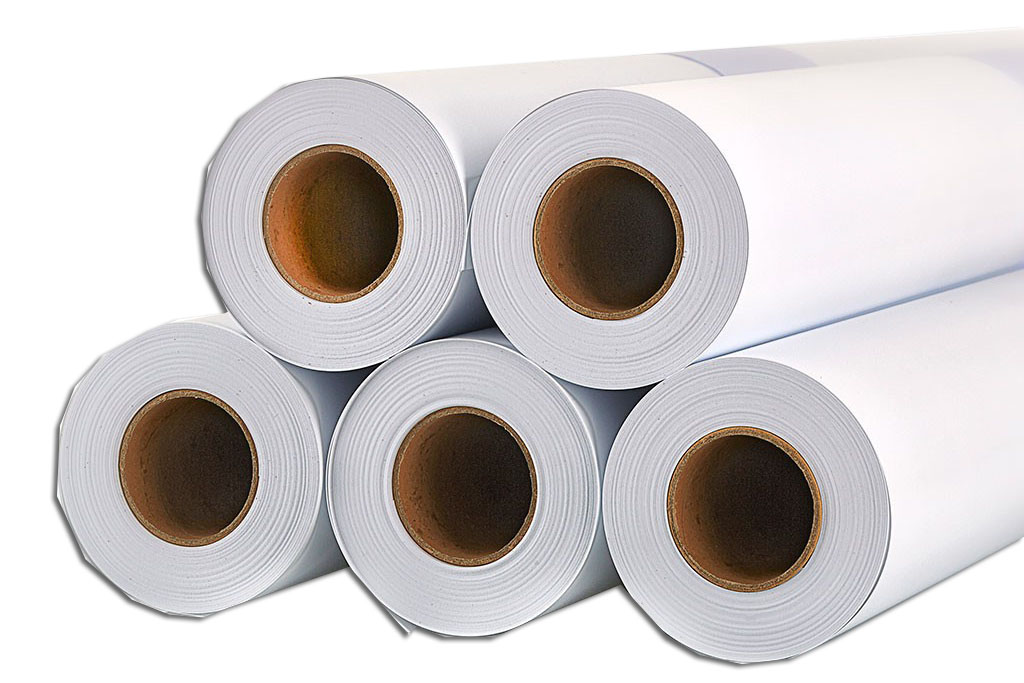 Five white opaque self adhesive vinyl rolls stacked one on top of another
