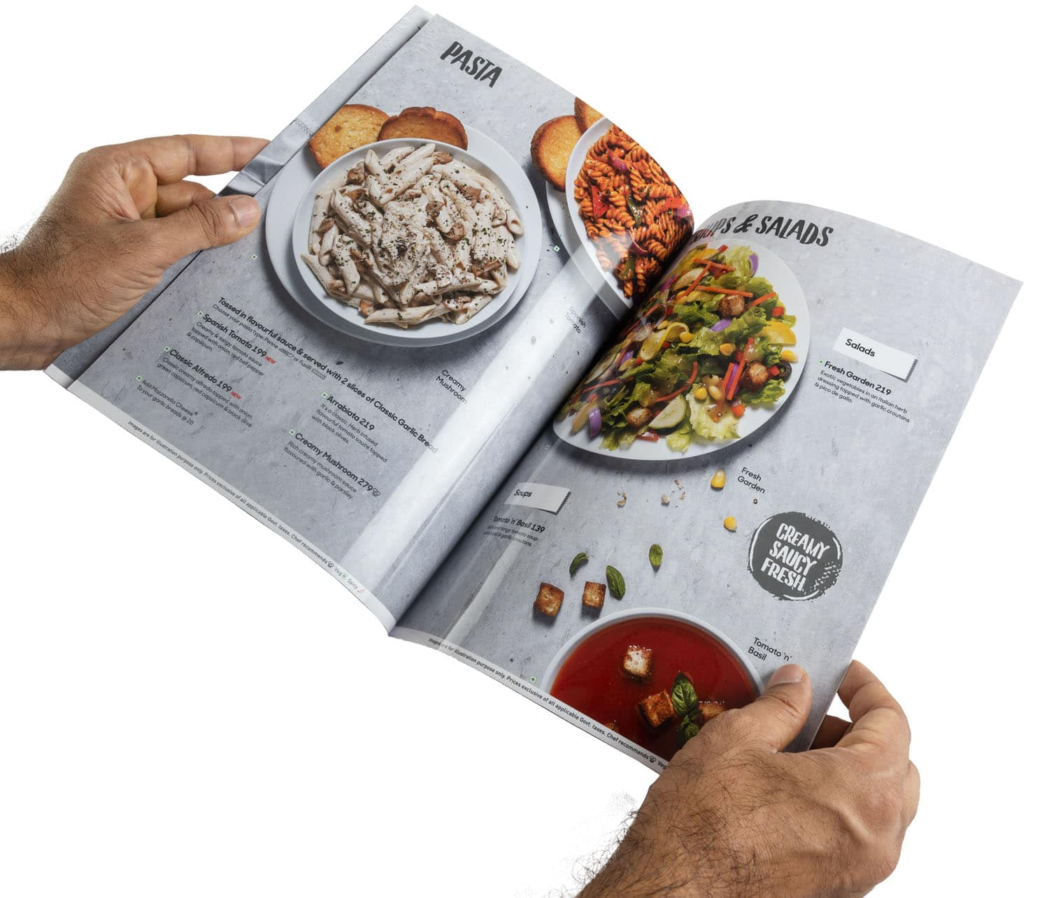 Glossy high resolution restaurant menu card printed as a booklet held open to show images of pasta salad and soups