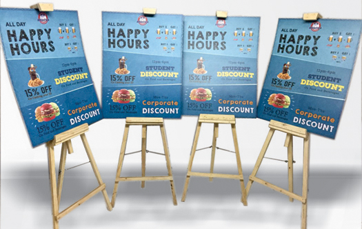 wooden easel standees with sunboard prints to catch the customers attention