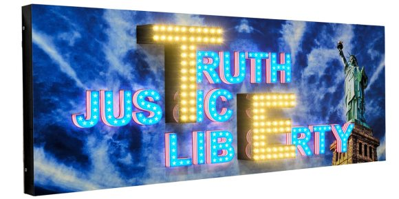 3D acrylic letters on a sign board with open, dot LEDs fixed on top to make the board shine very brightly. In-cut acrylic letters on the side spelling out the word 'Truth, Justice, Liberty'. Statue of Liberty image in the background on the ACP frame