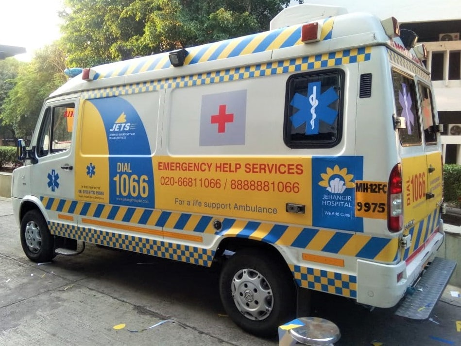 Cast vinyl prints of the Jehangir Hospital corporate colours, logo and emergency helpline pasted on their ambulance